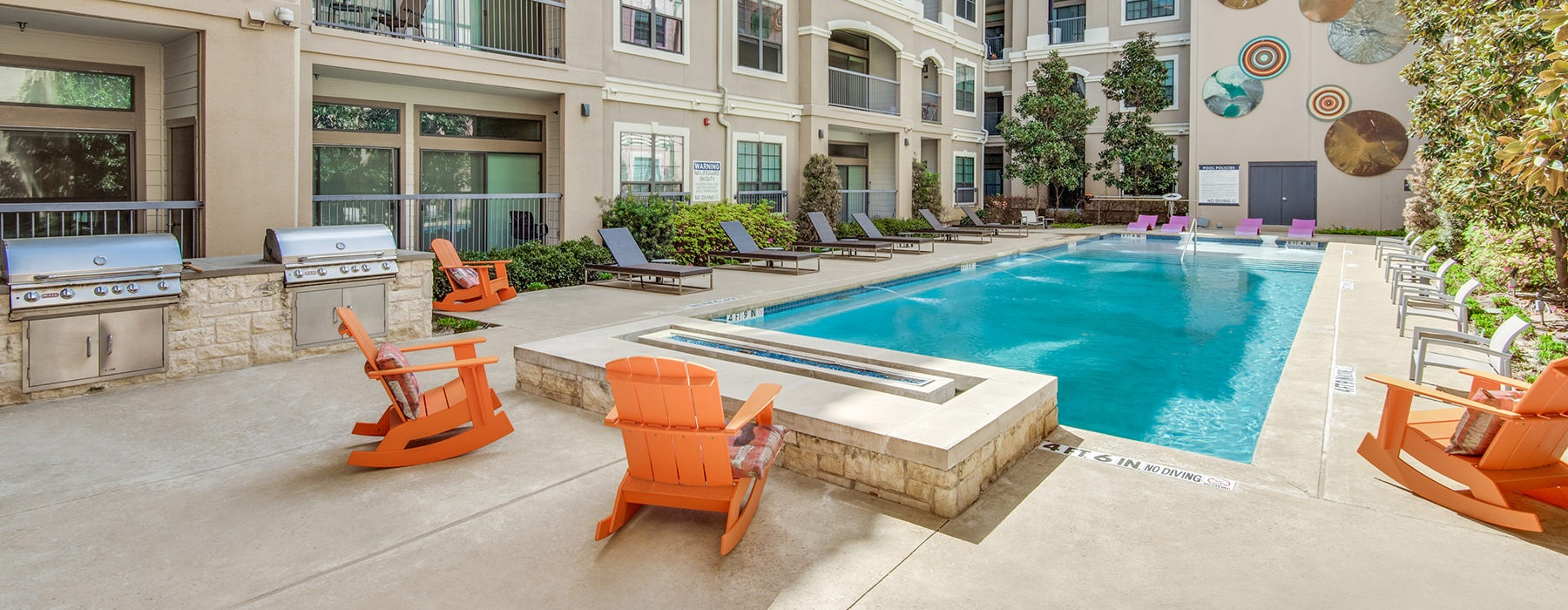 Large sparkling pool with sundecks and ample lounge chairs.